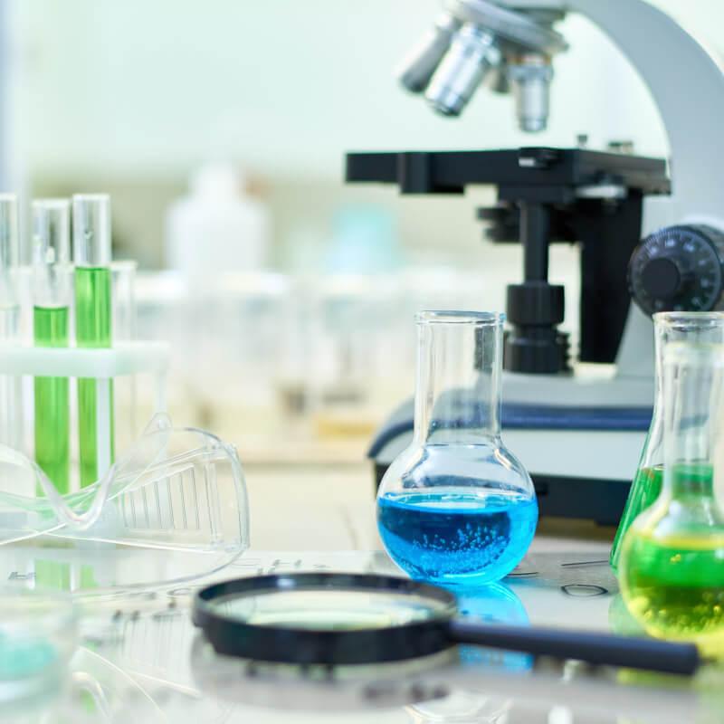 microscope and scientific beakers